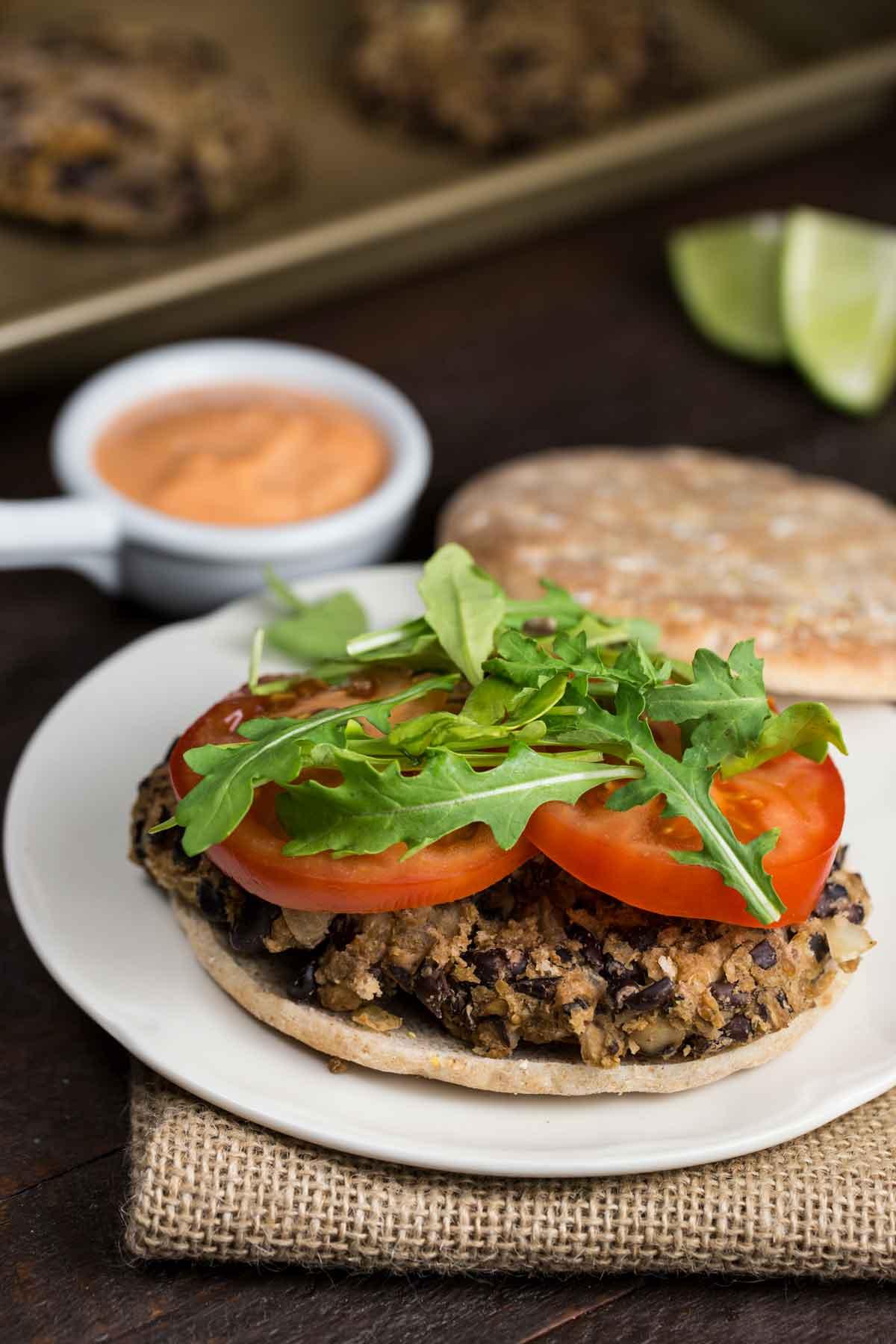 Skinny Shiitake Black Bean Burgers with Spicy Aioli Sauce | via veggiechick.com #vegan