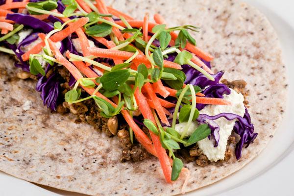 Healthy Lentil-Nut Tacos w/ Creamy Cashew-Avocado Sour Cream via veggiechick.com #vegan #vegetarian #tacos