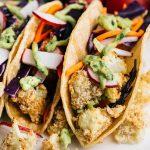 Crunchy Cauliflower Tacos w/ Avocado Lime Sauce | via veggiechick.com #vegan
