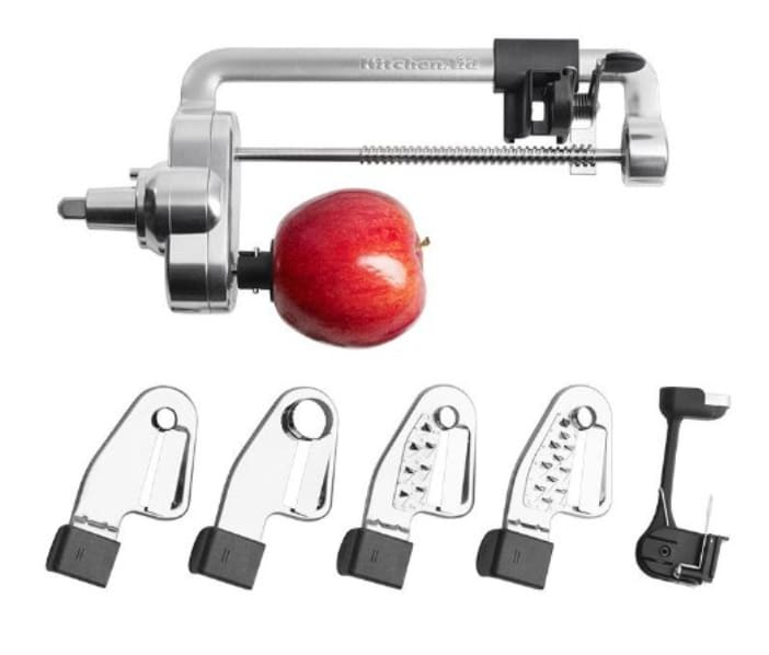 Kitchenaid spiralizer attachment for Kitchenaid blender, shown with apple on the end of the attachment, showing it is also an apple corer. All blades shown.