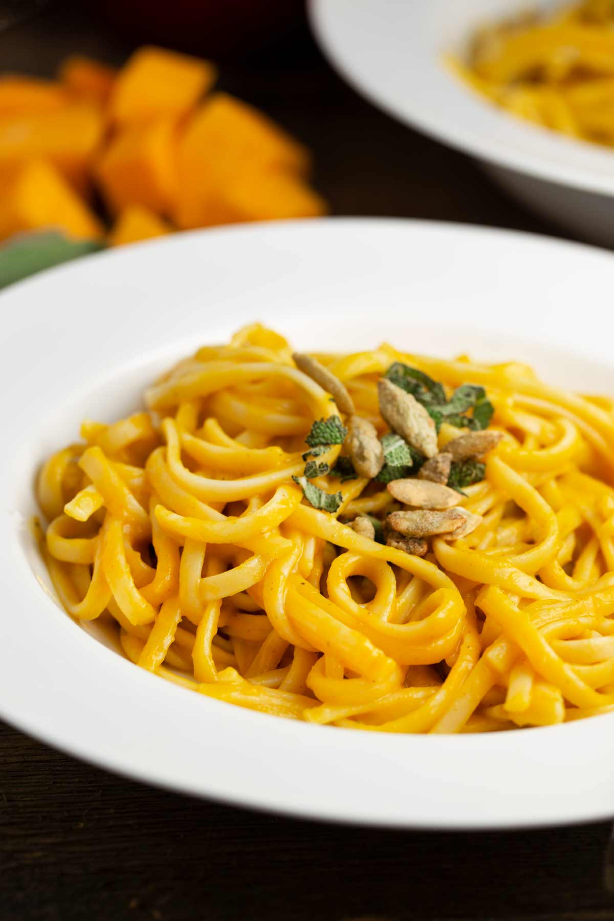 Roasted Butternut Squash Pasta topped with fresh sage and pumpkin seeds.