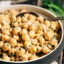 A black bowl filled with lemon chickpeas