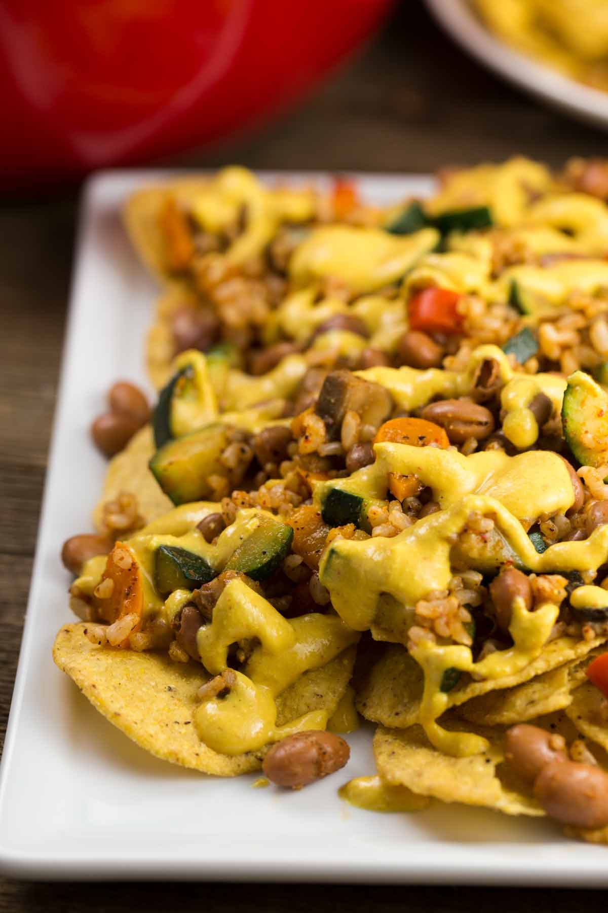 Vegan Nachos with Queso Cheese | via veggiechick.com #vegan #glutenfree #oilfree