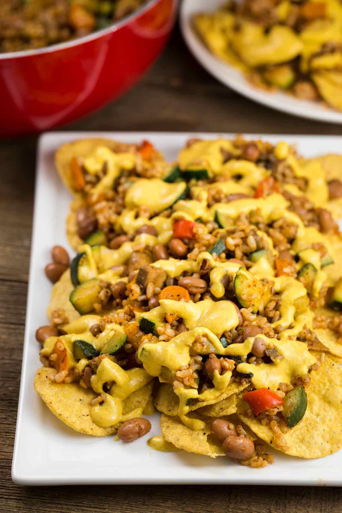 Vegan Nachos with Queso Cheese   via veggiechick.com #vegan #glutenfree #oilfree