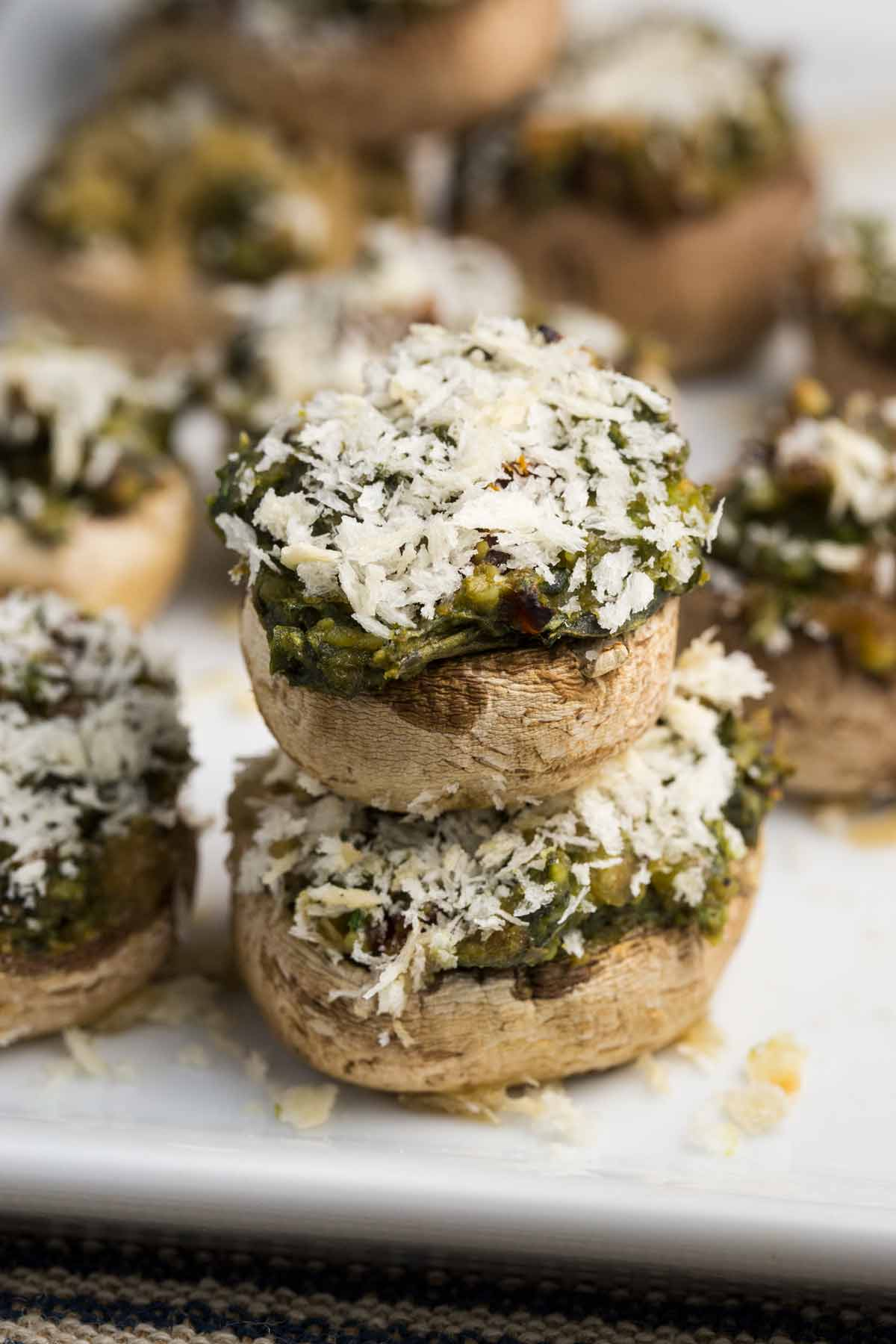 These Pesto Stuffed Mushrooms are oil and dairy free, and super easy to whip up for company, or an appetizer for the family.