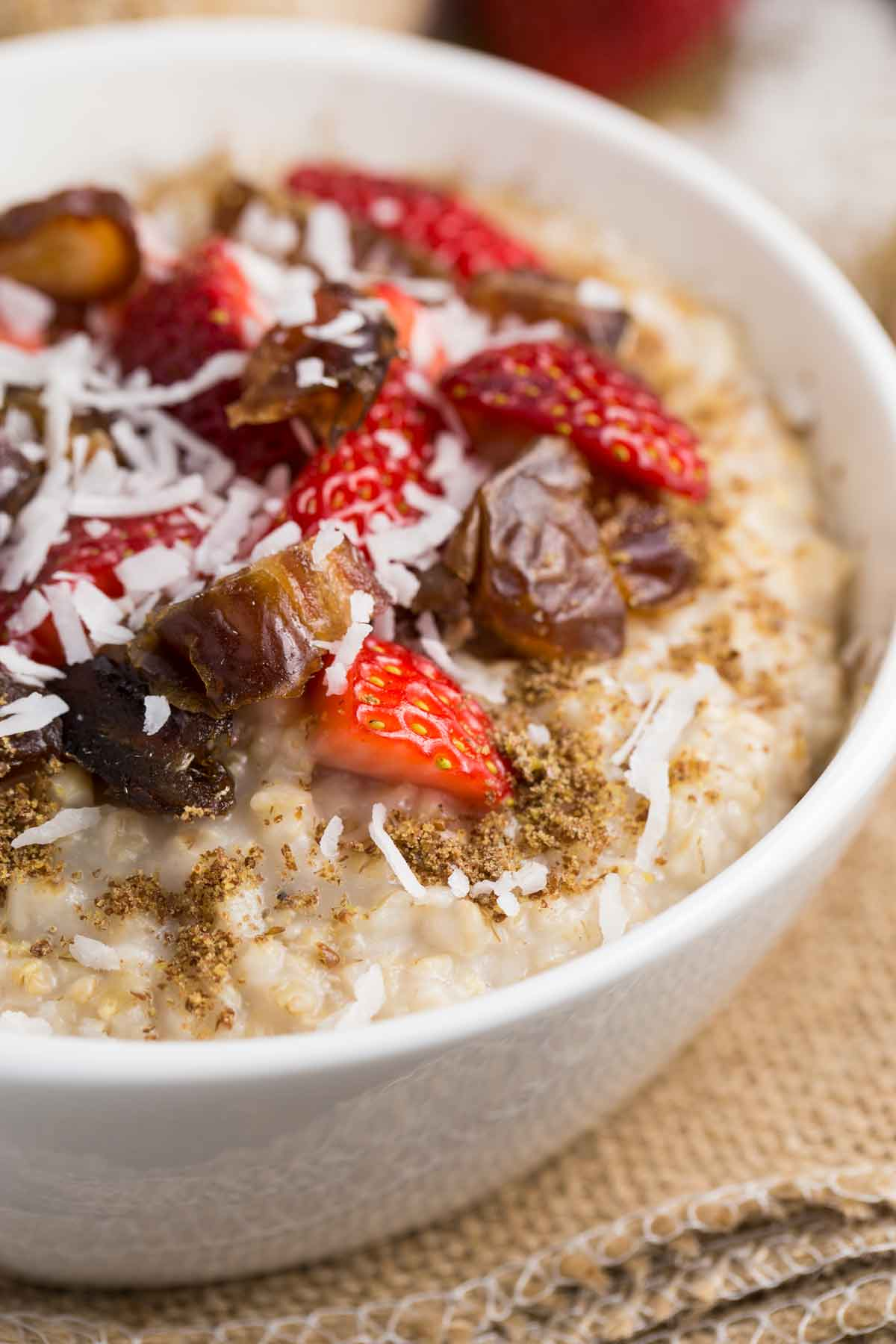 Steel cut oatmeal topped with berries, dates, brown sugar and coconut flakes.