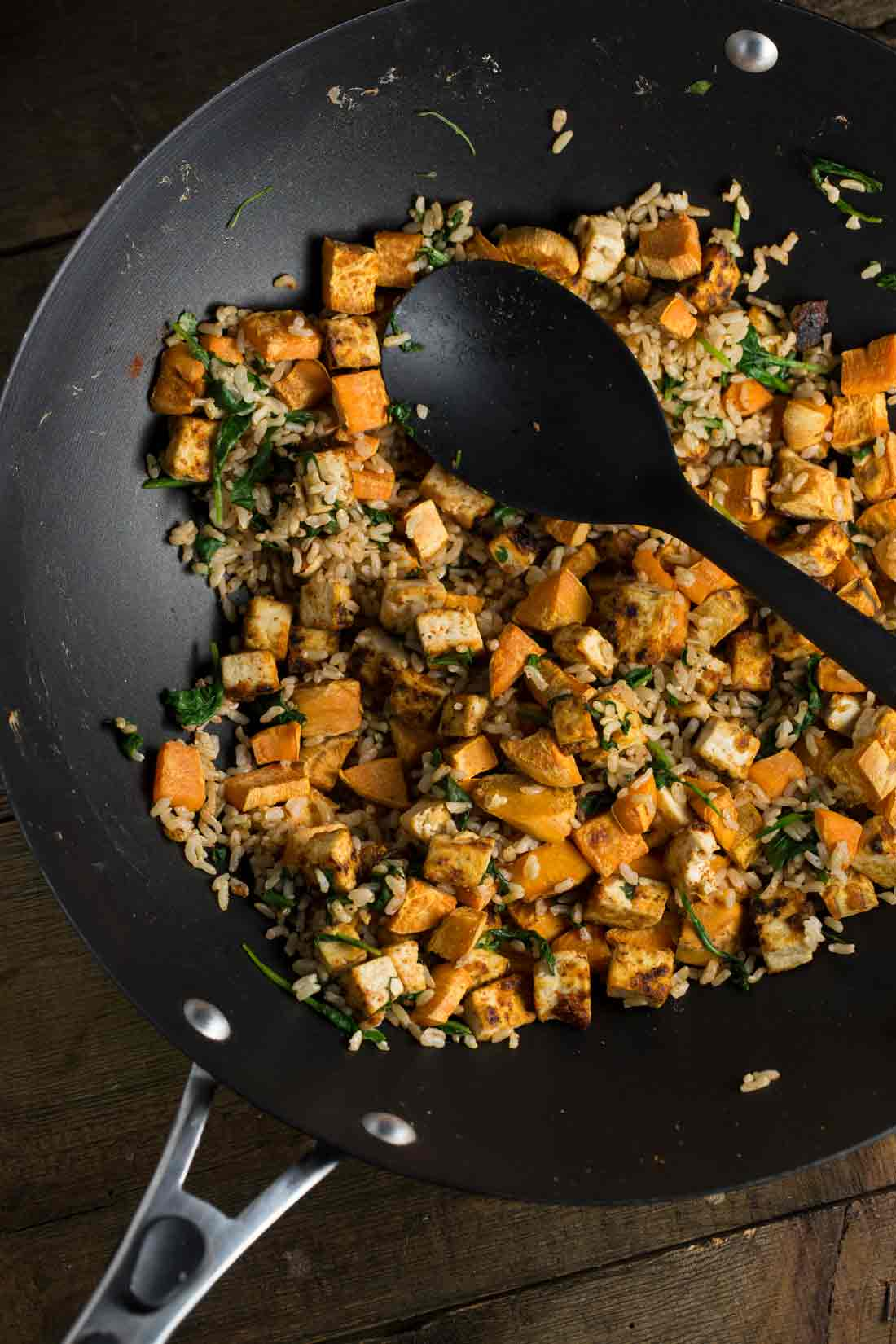 Overhead view of tofu, stir fried with rice, spinach and sweet potatoes.