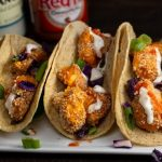 Buffalo Cauliflower Tacos via veggiechick.com | #vegan #oilfree