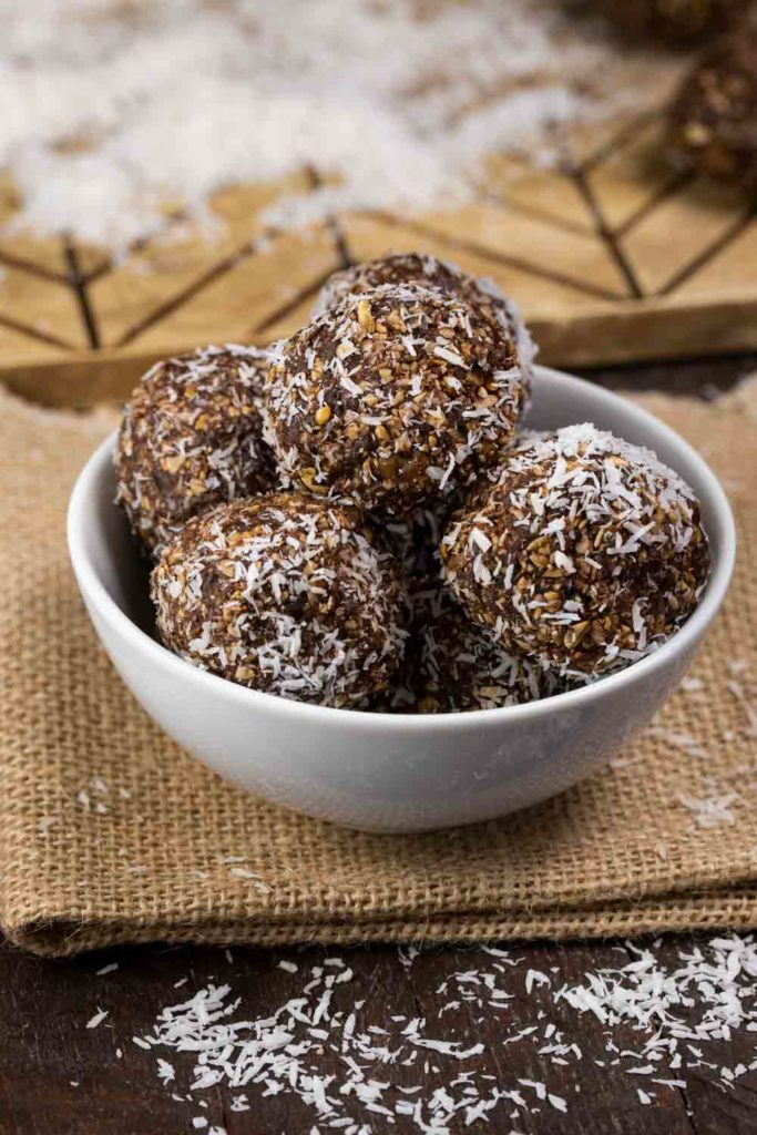 No Bake chocolately energy bites covered in shredded coconut.