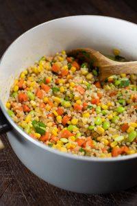 Israeli couscous with veggies in a saucepan