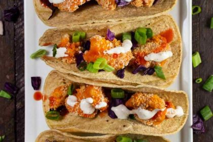 Vegan Buffalo Cauliflower Tacos on a white plate.