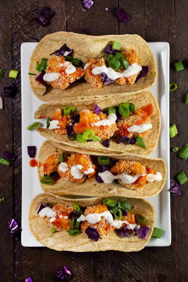 Vegan Buffalo Cauliflower Tacos on a white plate.