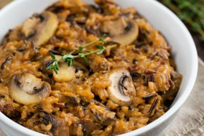 Instant Pot Wild Rice in a white bowl with a fork.
