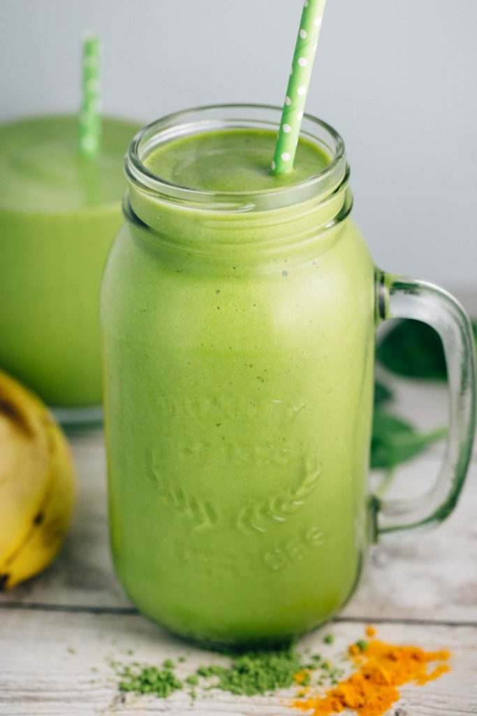 A mason jar filled with a Turmeric Green Tea Smoothie.