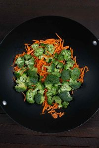 Broccoli and carrots in a wok