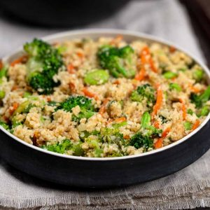 Cauliflower Rice Stir Fry in a black bowl on a napkin.