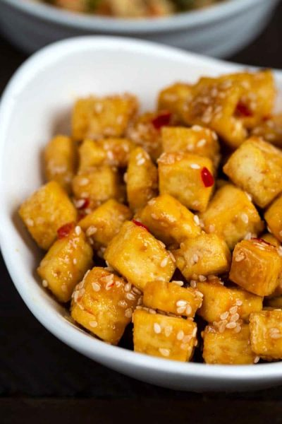Crispy Sesame Tofu in a white bowl