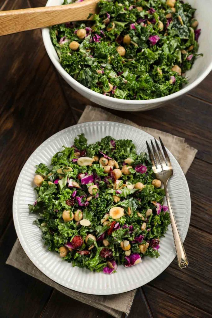Kale Cranberry Salad in a white bowl with a fork.