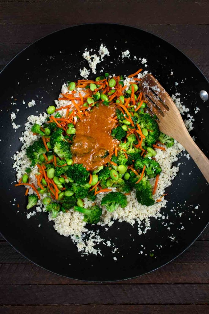 Stir fry of carrots, edamame and broccoli in a bowl with cauliflower rice