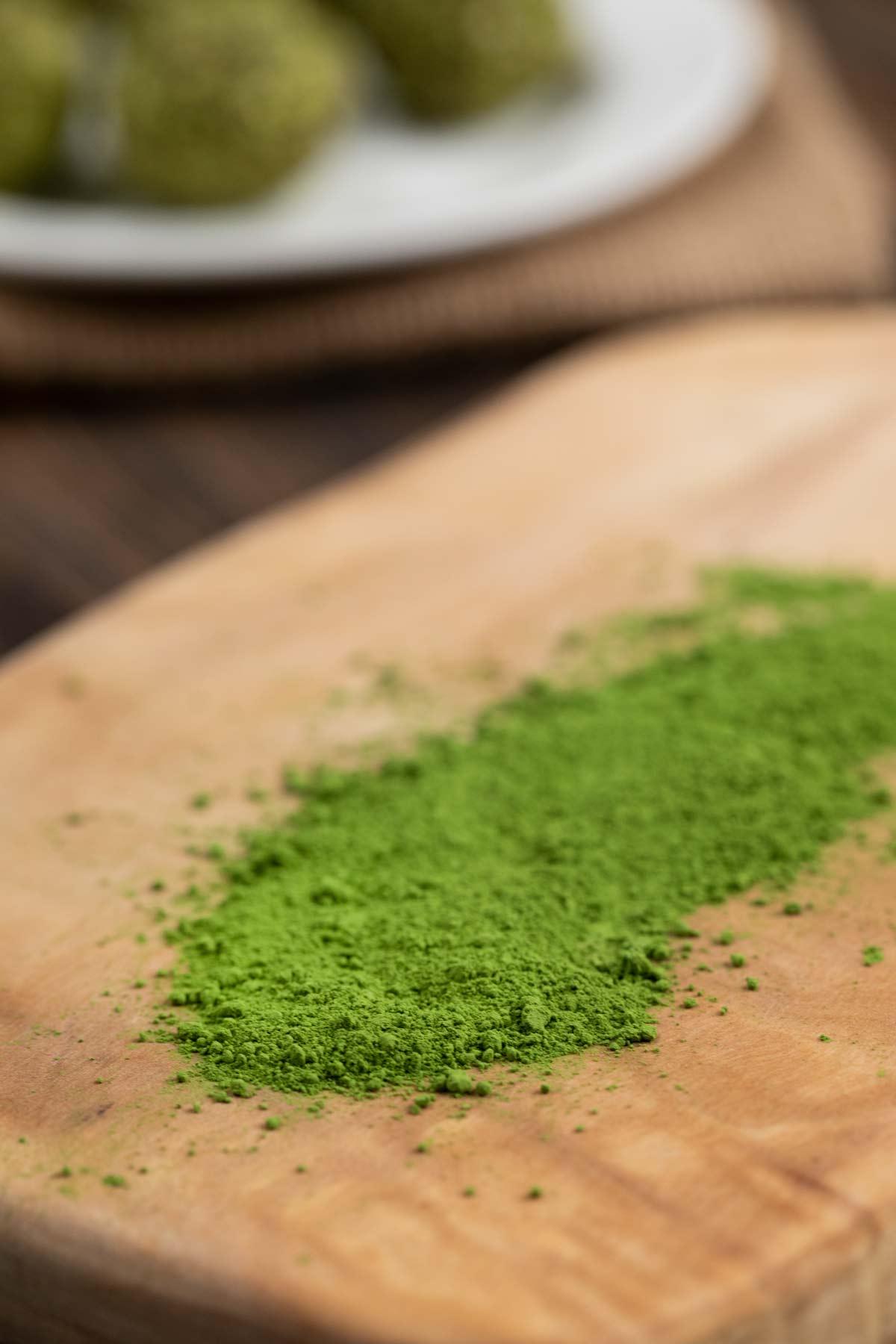 A cutting board with matcha green powder.