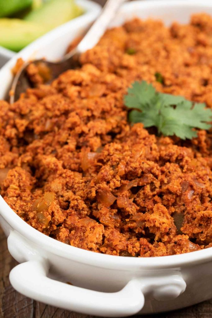 A close up image of a bowl of vegan soy chorizo.