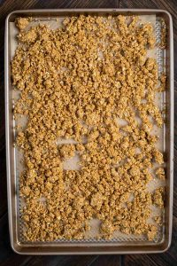 Granola on a baking pan ready to be baked.