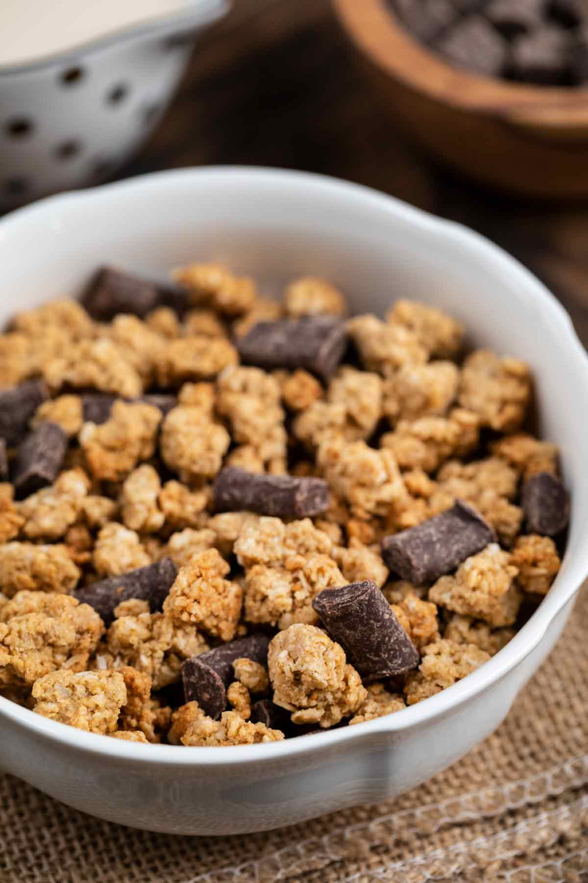 A bowl of baked granola with chocolate chunks.