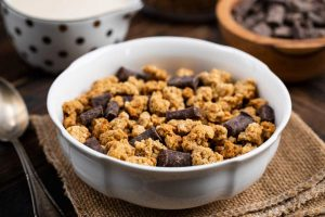 Baked Granola with chocolate chunks in a white bowl