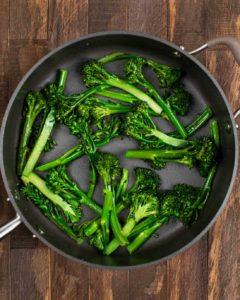 Sauteed broccolini in a pan