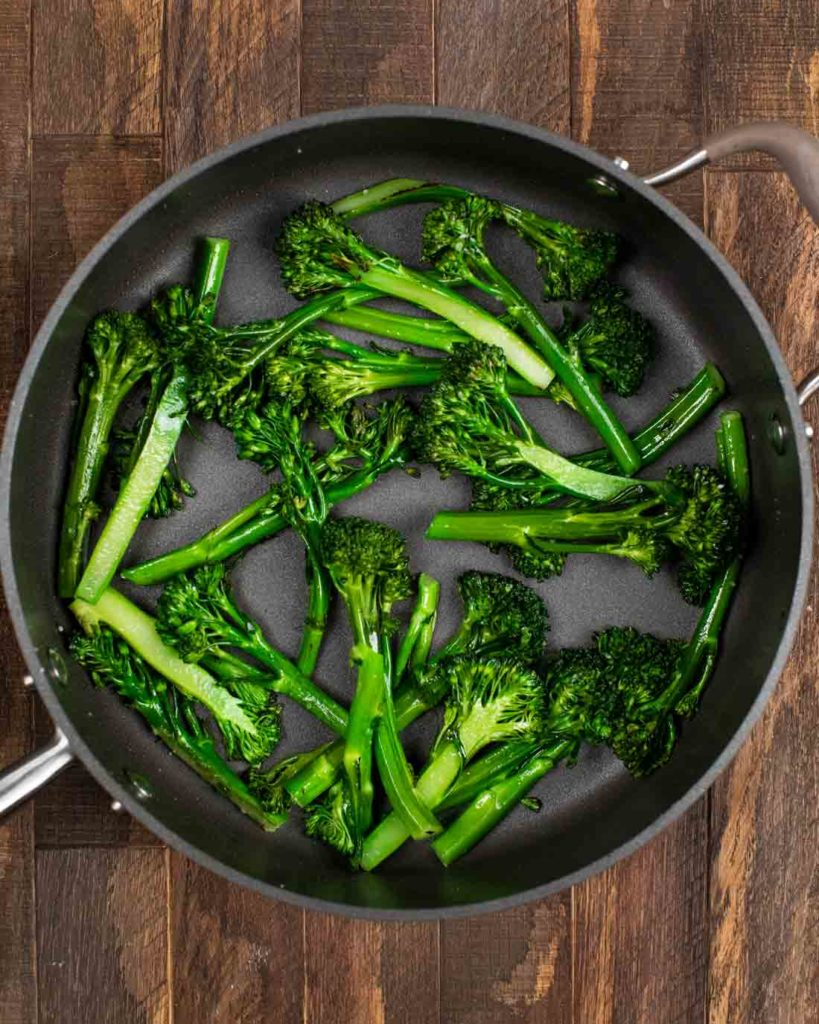 A skillet filled with sautéed broccolini