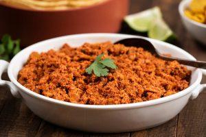Homemade Soy Chorizo Recipe in a white bowl with cilantro garnish