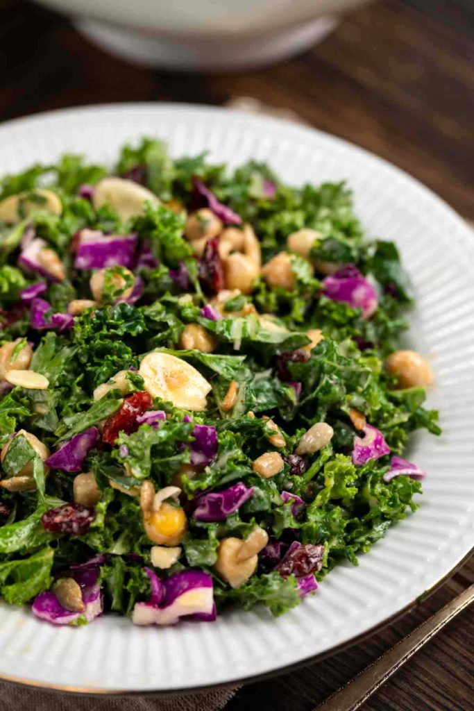 Kale salad with cranberries, sliced almonds, cabbage, sunflower seeds.