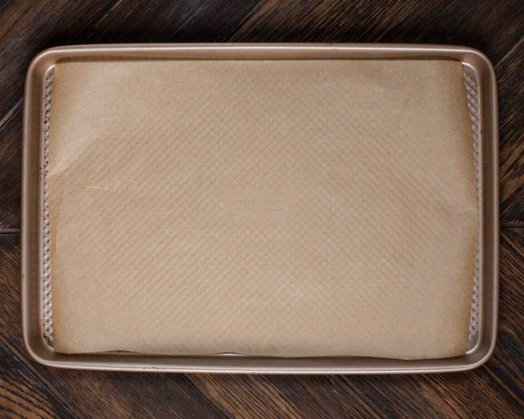A baking pan covered with parchment paper.