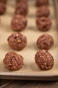 Chocolate Raspberry Truffles mixed together and added to a baking sheet before freezing.