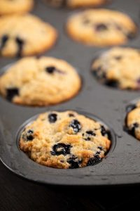Close up shot of blueberry Muffin batter in a muffin pan