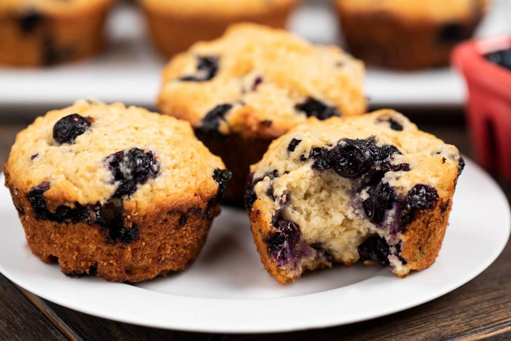 A plate of blueberry muffins