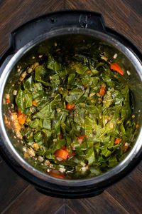 An instant pot filled with instant pot collard greens after cooking.