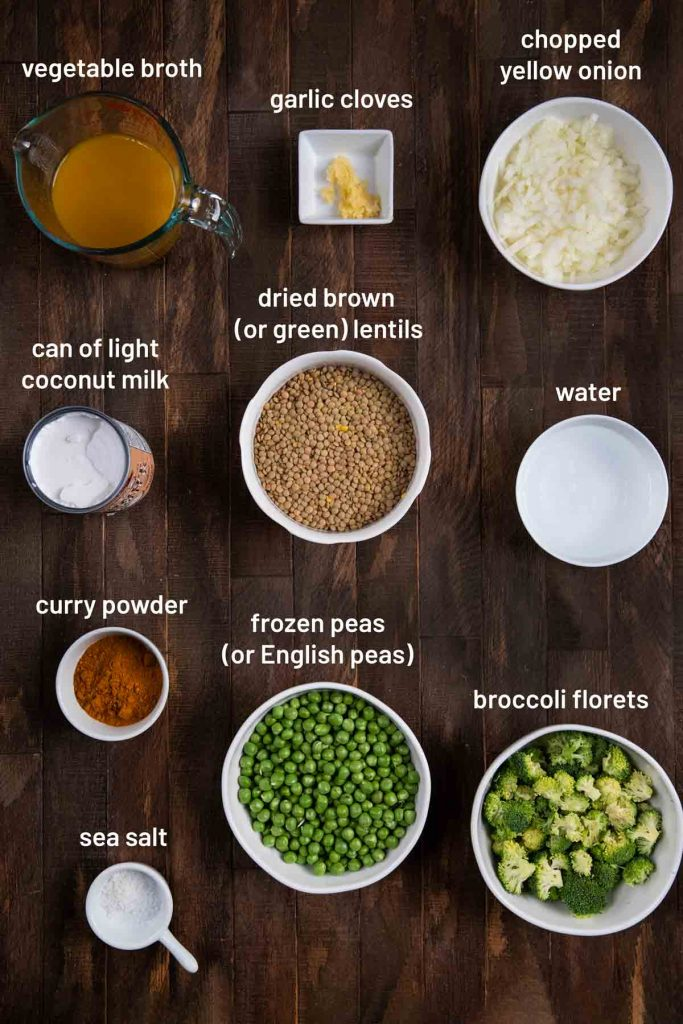 A photo showing all of the ingredients for lentil curry, including vegetable broth, coconut milk, garlic, onion, lentils, water, curry powder, peas, broccoli, and salt.