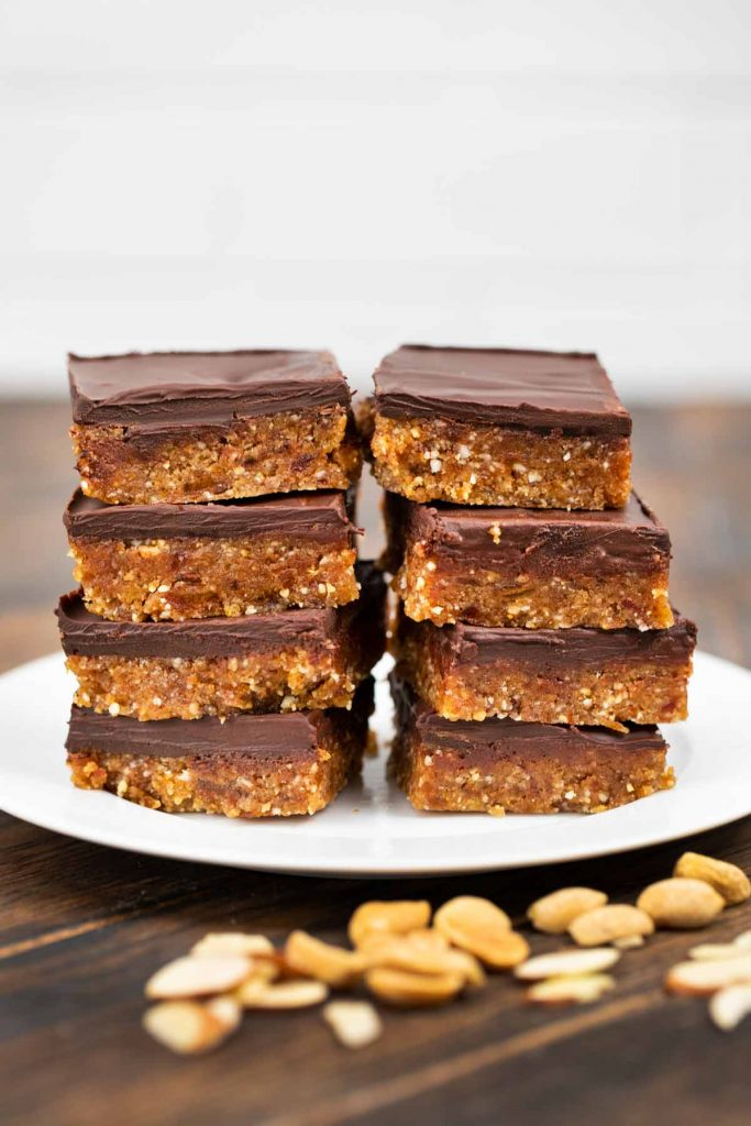 A plate of 8 pieces of vegan peanut butter chocolate bars.